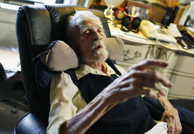 111 year-old Alexander Imich the world's oldest living man speaks during an interview with Reuters at his home on New York City's upper west side, May 9, 2014. Dr. Imich, who holds a Ph.d in Zoology, was born in Poland on February 4,1903, fled Poland when the Nazis took over in 1939, survived a slave labor camp in Russia and moved to the United States in 1951 where he became an author on parapsychology. REUTERS/Mike Segar (UNITED STATES - Tags: SOCIETY)