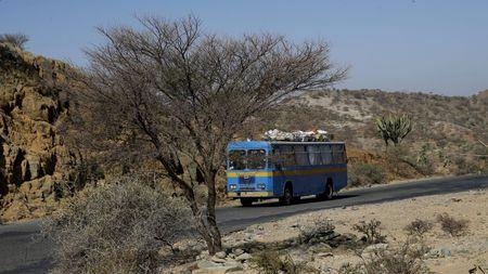 A passenger bus drives on the main highway near the town of Akordat west from Eritrea's capital Asmara, February 17, 2016. REUTERS/Thomas Mukoya