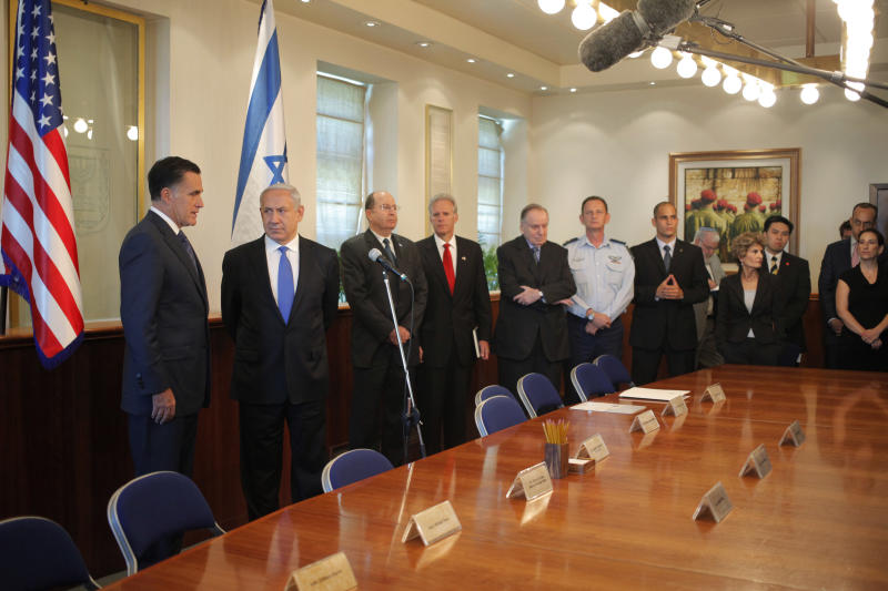 FILE - In this Sunday, July 29, 2012 file photo, Republican presidential candidate and former Massachusetts Gov. Mitt Romney, left, meets with Israel's Prime Minister Benjamin Netanyahu, second left, at his office in Jerusalem. It is a taboo for Israeli leaders to give even the slightest hint of favoritism in politics in the United States, Israel's closest ally. So some Israelis are squirming over a perception that Prime Minister Benjamin Netanyahu is siding with Republican Mitt Romney in the U.S. presidential race, in the belief he would take a harder line on archenemy Iran. That, some fear, is putting Israel's alliance with Washington at risk if Barack Obama wins. (AP Photo/Charles Dharapak)