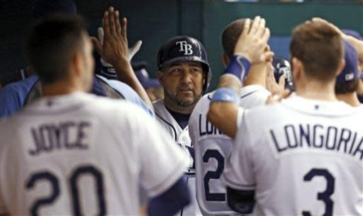 Tampa Bay Rays' Jose Molina, center, is congratulated by teammates after his two-run home run during the second inning of a baseball game against the Chicago White Sox on Friday, July 5, 2013, in St. Petersburg, Fla. (AP Photo/Mike Carlson)