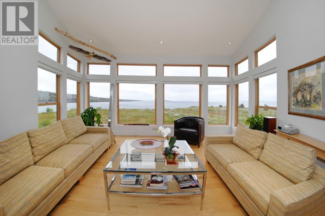 "<p><a rel=""nofollow"">200 Point Road, Bryant's Cove, Nfld.</a><br />The massive windows let you take in the 270-degree view of Conception Bay from the cozy comfort of home.<br />(Photo: Zoocasa) </p>"