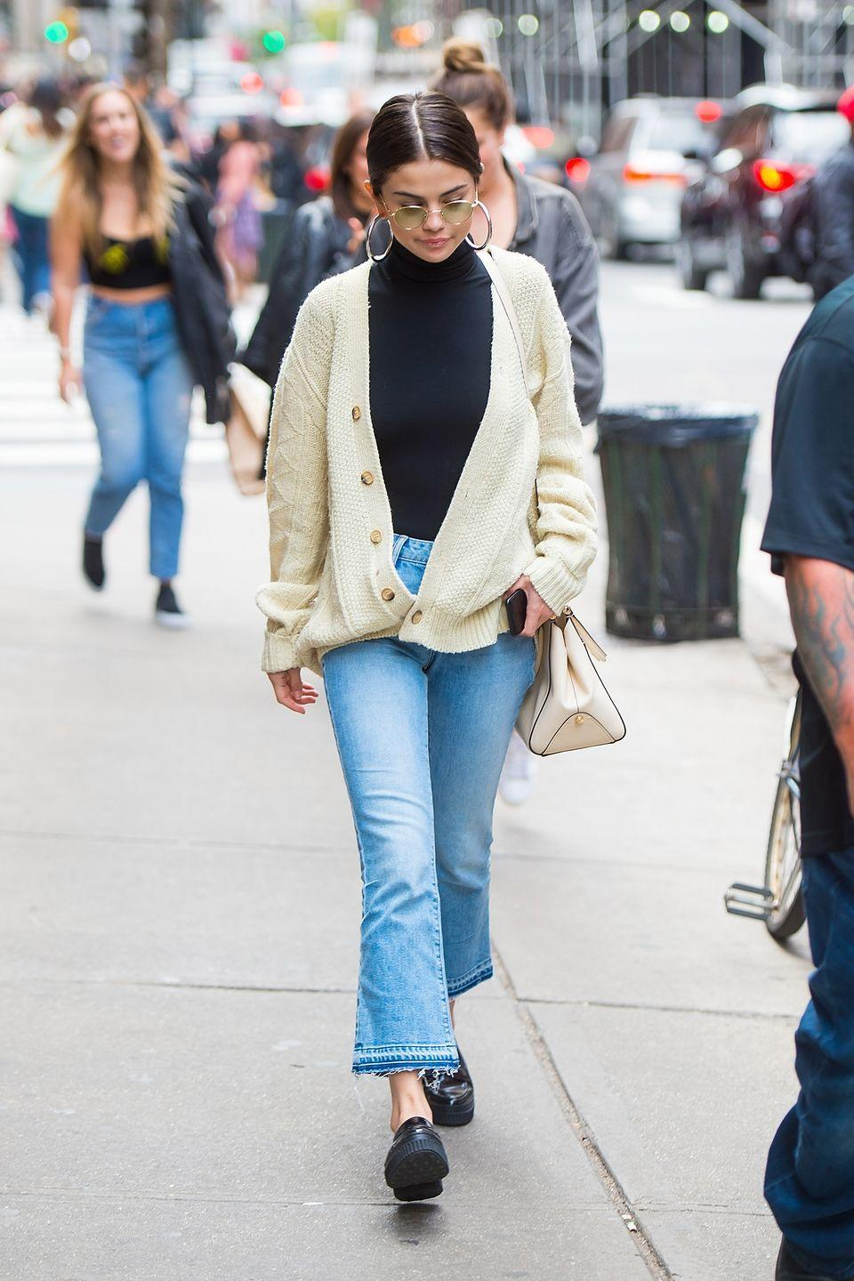 <p>The 'Bad Liar' crooner went for a cosy look during an outing in NYC, sporting a cream-coloured knit over a black turtle neck sweater and washed-out jeans, September 2017.</p>