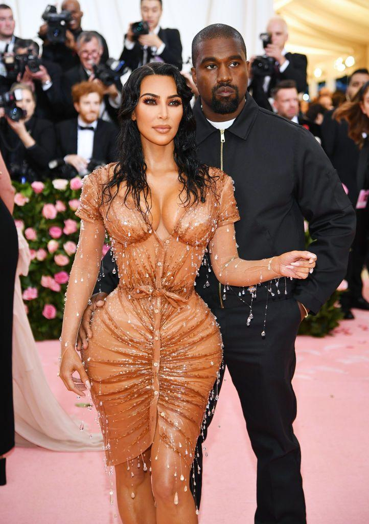 <p>Kardashian wore this Thierry Mugler wet look for last year's Met Gala, where West accompanied her.</p>