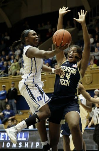 Duke's Chelsea Gray drives to the basket against Georgia Tech's Shayla Bivins (24) during the first half of an NCAA women's college basketball game in Durham, N.C., Thursday, Dec. 6, 2012. (AP Photo/Gerry Broome)