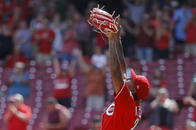 Cincinnati Reds relief pitcher Raisel Iglesias celebrates after closing the ninth inning of a baseball game against the San Diego Padres, Wednesday, Aug. 21, 2019, in Cincinnati. (AP Photo/John Minchillo)