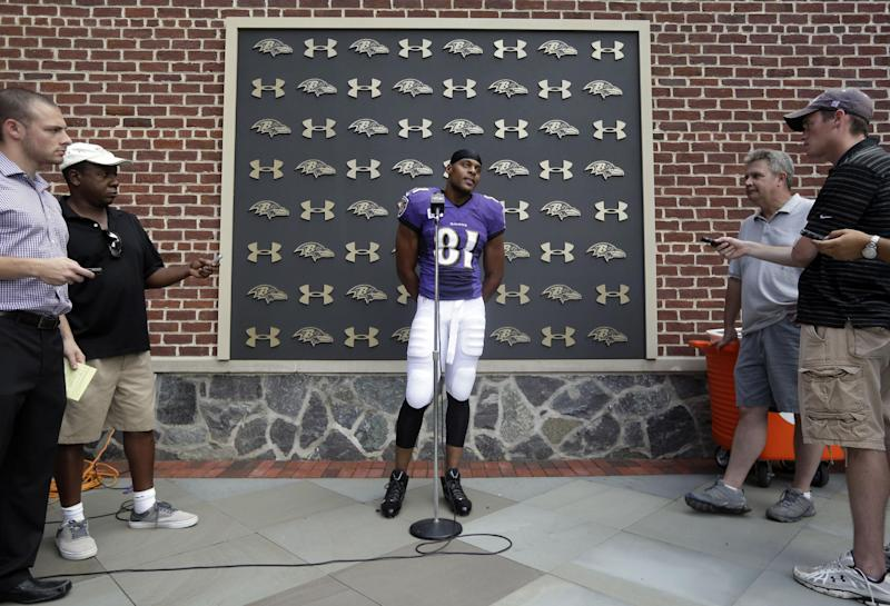 Baltimore Ravens tight end Visanthe Shiancoe, center, speaks at a news conference after NFL football training camp at the team's practice facility in Owings Mills, Md., Sunday, July 28, 2013. (AP Photo/Patrick Semansky)