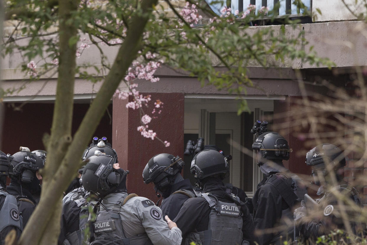 Dutch counter terrorism police prepare to enter a house after a shooting incident in Utrecht, Netherlands, Monday, March 18, 2019. P(Photo: Peter Dejong/AP)