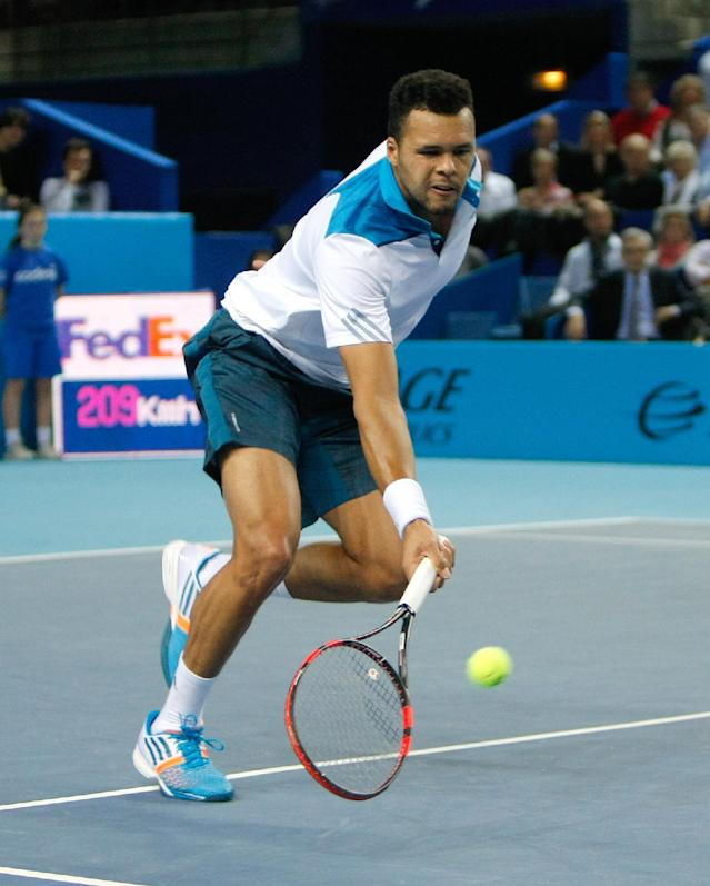 France's Jo-Wilfried Tsonga returns the ball to Ernests Gulbis of Latvia, during their final match, at the Open 13 tennis tournament, in Marseille, southern France, Sunday, Feb. 23 , 2014. (AP Photo/Claude Paris)