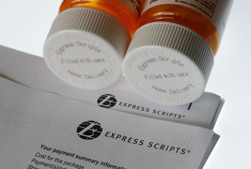 FILE - In this July 25, 2017, file photo, Express Scripts prescription medication bottles are arranged for a photo in Surfside, Fla. Health insurer Cigna will spend about $52 billion to acquire the pharmacy benefits manager Express Scripts, announced Thursday, March 8, 2018, the latest in a string of proposed buyouts and tie-ups in a rapidly shifting landscape for the health services industry. (AP Photo/Wilfredo Lee, File)