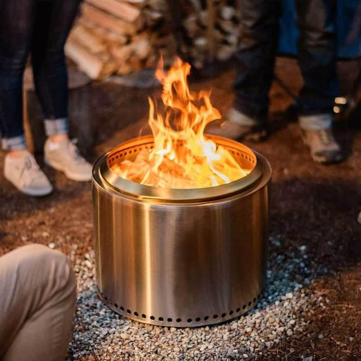 """Grab some fresh graham crackers and marshmallows, this pit was made for s'mores! Crafted with stainless steel, this portable pit emits minimal ash and smoke thanks to its patented technology. $350, Solo Stove. <a href=""""https://www.solostove.com/solo-stove-bonfire/"""" rel=""""nofollow noopener"""" target=""""_blank"""" data-ylk=""""slk:Get it now!"""" class=""""link rapid-noclick-resp"""">Get it now!</a>"""