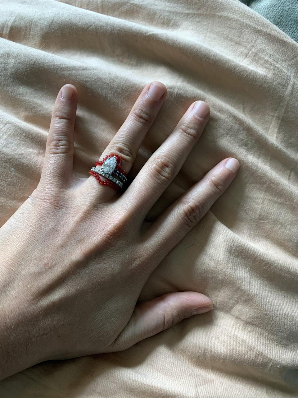 <p>Jillian sent me wax models of the rings so I could try them on with my engagement ring. That was when I discovered I'd rather have a simple, straight band at the bottom instead of something curved. All the other details would stay the same.</p>