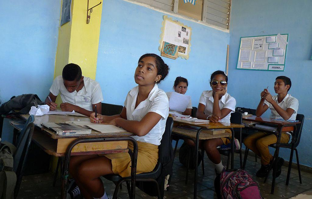 <p>Carmen Gonzalez (near C) sits in her classroom a few days before her quinceanera (coming-out for 15-year-olds) celebration, in Havana, Cuba. As nearly all Cuban girls dream of having a quinceanera, the industry that moves around that dream is large, with clients ranging from wealthy Cuban-Americans who travel back to the island to sponsor lavish parties, to regular Cubans who save a few hundred dollars over several years from their monthly $18 state wage.</p>