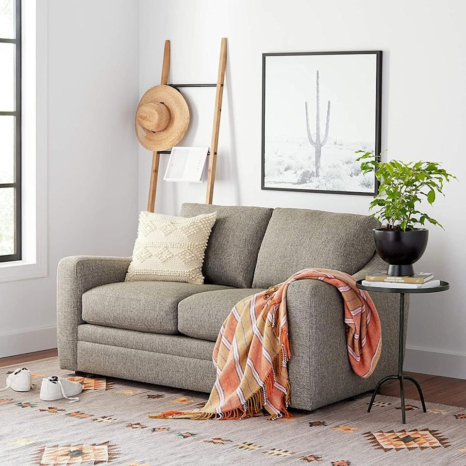 <p>You can hang your favorite throw blankets on this <span>Rivet Contemporary Fir Decorative Blanket Ladder</span> ($62).</p>