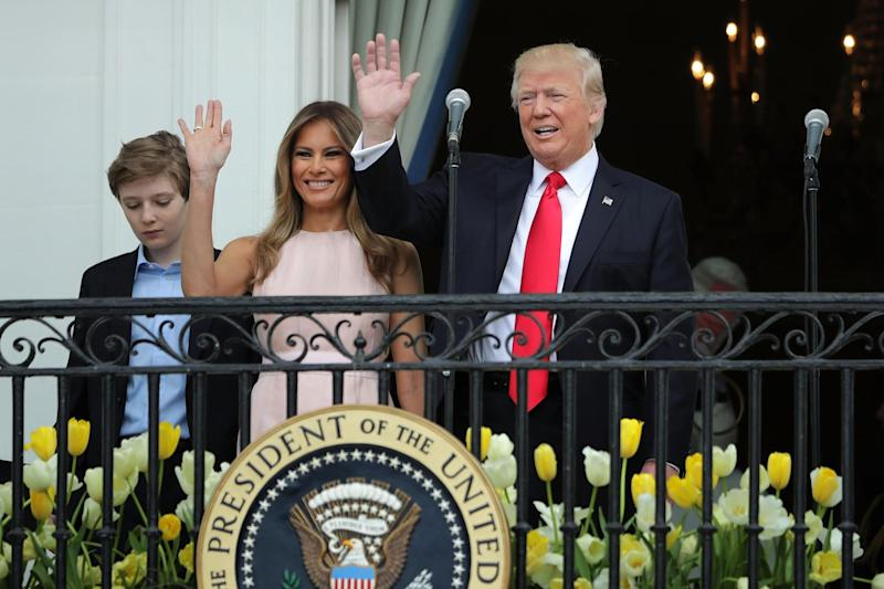 Picture: President Donald Trump and first lady Melania Trump wave to guests from the Truman Balcony with their son Barron Trump during the 139th Easter Egg Roll on the South Lawn of the White House April 17, 2017 in Washington, DC: (Chip Somodevilla/Getty Images)