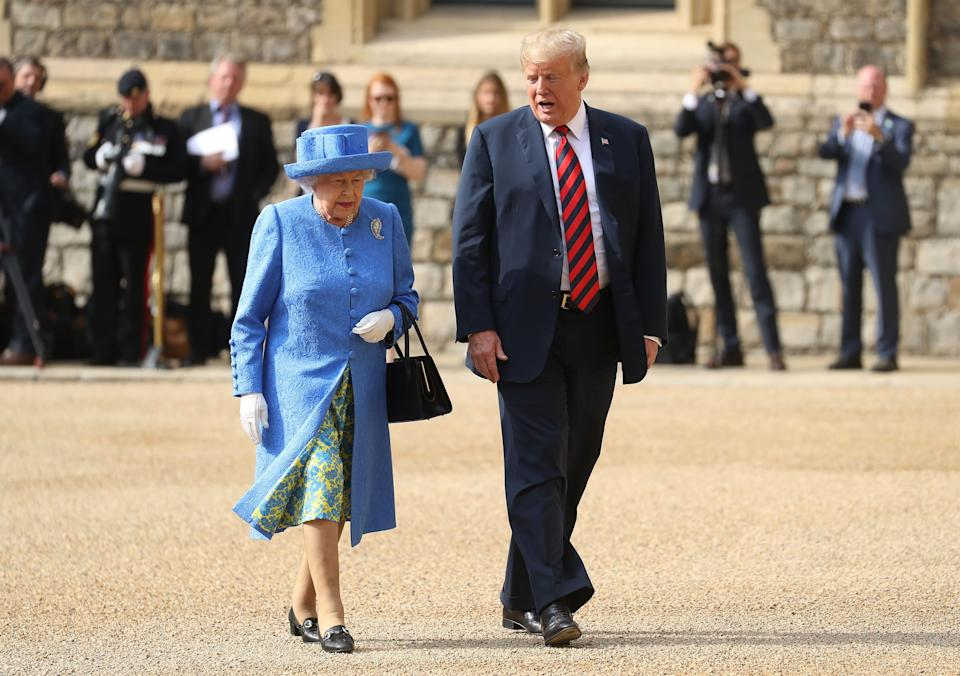 US President Donald Trump (R) and Britain's Queen Elizabeth II (L) leave the Quadrangle after inspecting a Guard of Honour during a ceremonial welcome at Windsor Castle in Windsor, west of London, on July 13, 2018 on the second day of Trump's UK visit. - US President Donald Trump on Friday played down his extraordinary attack on Britain's plans for Brexit, praising Prime Minister Theresa May and insisting bilateral relations