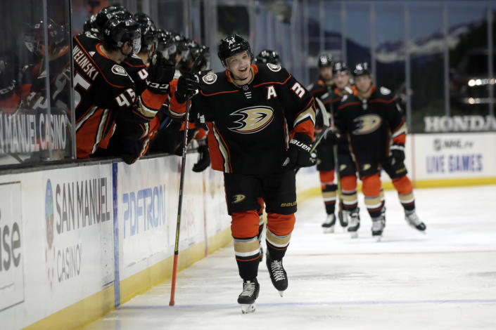 Anaheim Ducks right wing Jakob Silfverberg (33) celebrates with teammates after scoring against the Colorado Avalanche during the first period of an NHL hockey game in Anaheim, Calif., Sunday, Jan. 24, 2021. (AP Photo/Alex Gallardo)