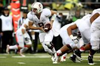 Stanford quarterback Kevin Hogan (8) runs with the ball during the first quarter against Oregon in an NCAA college football game in Eugene, Ore., Saturday, Nov. 1, 2014. (AP Photo/Ryan Kang)