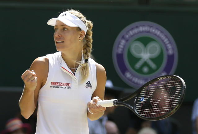 Germany's Angelique Kerber celebrates defeating Latvia's Jelena Ostapenko during their women's singles semifinals match at the Wimbledon Tennis Championships, in London, Thursday July 12, 2018. (AP Photo/Tim Ireland)