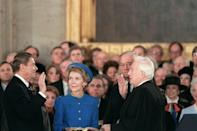 Ronald Reagan is sworn in as 40th President of the United States by Chief Justice Warren Burger beside his wife Nancy Reagan in the Capitol Rotunda in 1985