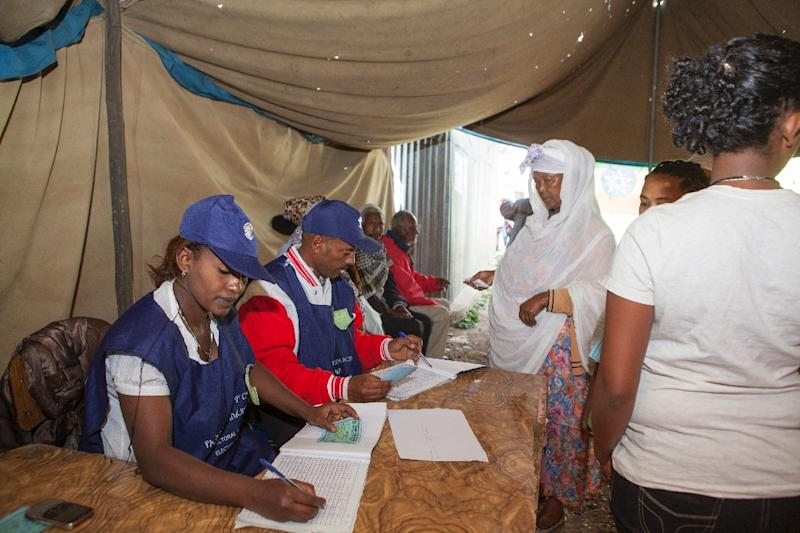 Ethiopian Electoral Board employees work at a polling station in Addis Ababa on May 24, 2015