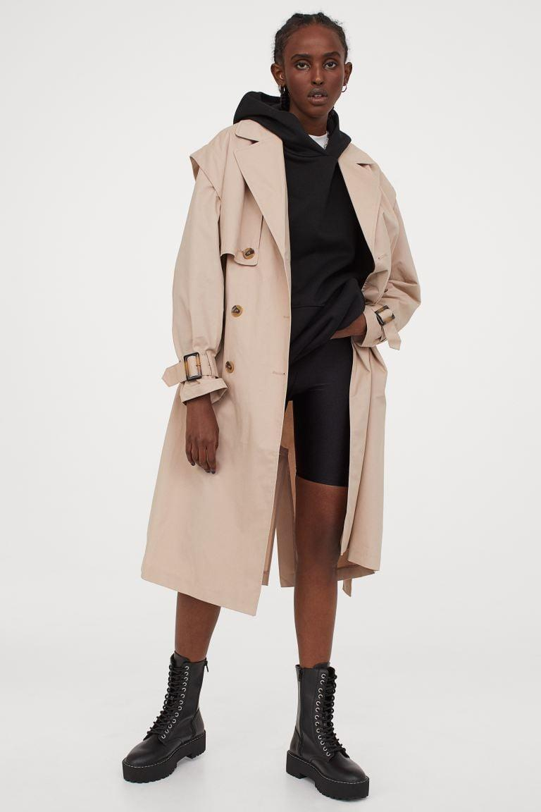 <p>The perfect throw on and go piece</p> <p><span>H&M Cotton Twill Trenchcoat</span> ($59)</p>