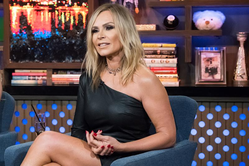Tamra Judge looks gorgeous in a low-cut one-hand black dress that is showing off her curves.