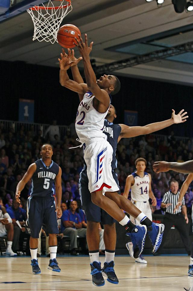 Kansas' Andrew Wiggins, front, receives a foul from Villanova's Tony Chennault during the second half of an NCAA college basketball game in Paradise Island, Bahamas, Friday, Nov. 29, 2013. (AP Photo/Bahamas Visual Services, Dante Carrer)