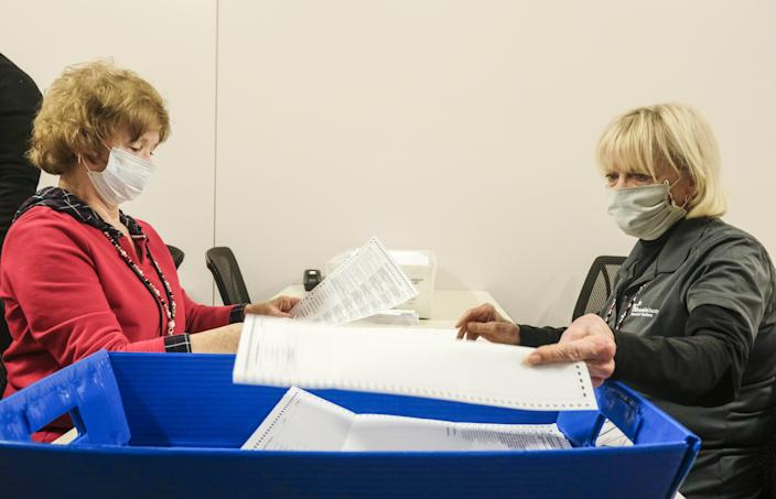 Employees and volunteers of the Franklin County Board of Elections sort through, and de-stub both mail in ballots and provisional ballots on April 28, 2020 in Columbus, Ohio on the final day of the the Primary Election. The election which was postponed on March 17, is almost exclusively mail in or absentee. The only residents allowed to vote in person are those who are disabled, have no permanent residence, or who requested a ballot by mail but never received it.