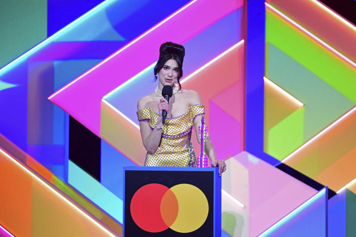 Dua Lipa accepts the award for Best Female Solo Artist during the Brit Awards 2021 at the O2 Arena, London, Tuesday, May 11, 2021. (Ian West/PA via AP)