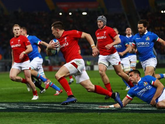Josh Adams runs in for Wales' opening try against Italy (Getty)