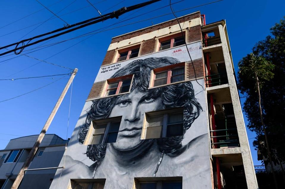"""<div class=""""inline-image__caption""""><p>A mural of Jim Morrison by Jonas Never aka @never1959 is seen at the Ellison estates in Venice on March 01, 2021, in Los Angeles, California.</p></div> <div class=""""inline-image__credit"""">Emma McIntyre/Getty</div>"""