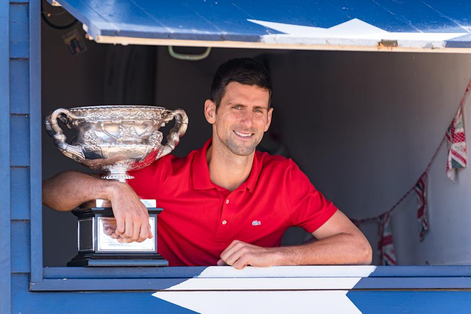 MELBOURNE, AUSTRALIA - FEBRUARY 22: Novak Djokovic of Serbia poses with the Norman Brookes Challenge Cup after winning the 2021 Australian Open Men's Final, at Brighton Beach on February 22, 2021 in Melbourne, Australia. (Photo by Andy Cheung/Getty Images)