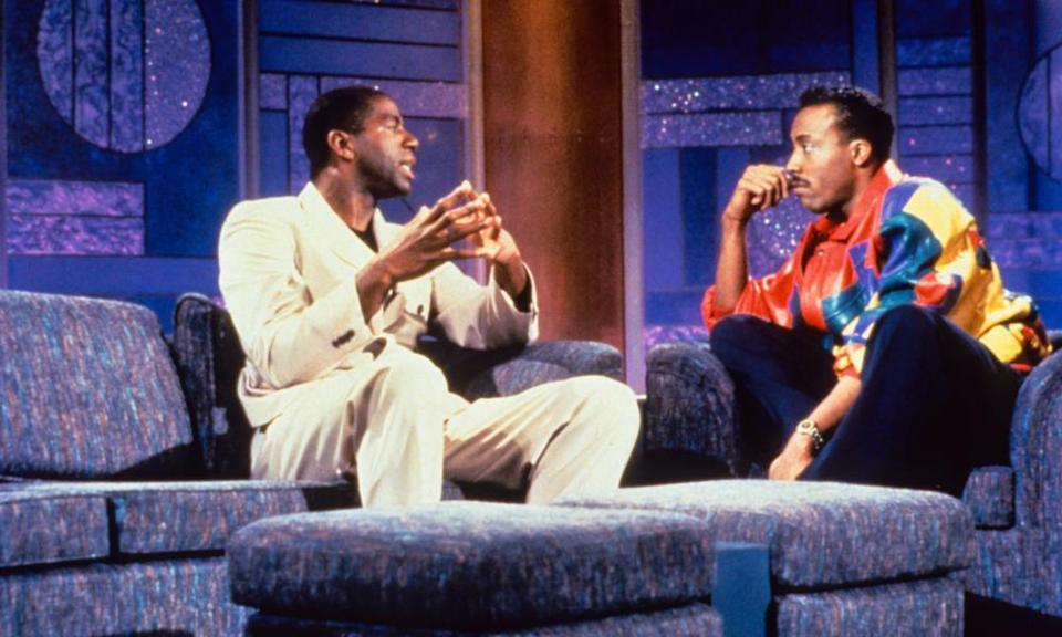 Earvin 'Magic' Johnson and Arsenio Hall.