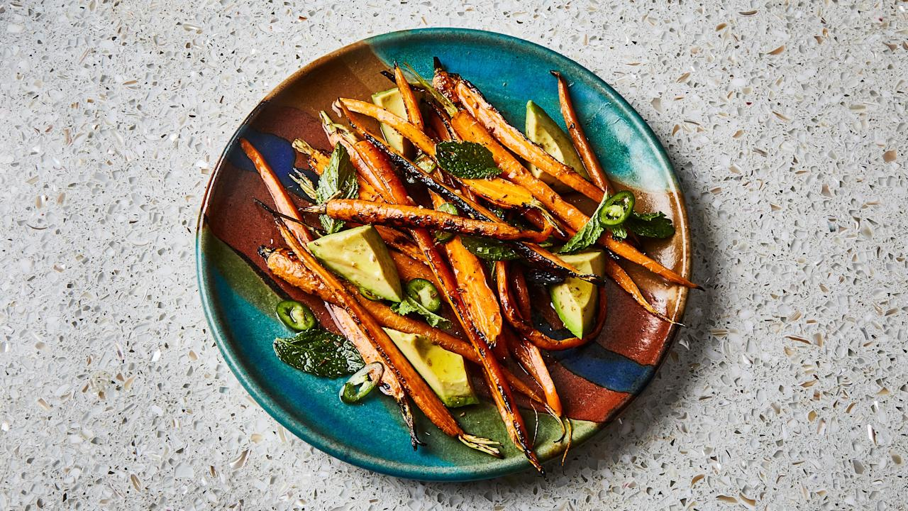 """You actually don't have to bother with peeling the carrots for this recipe—not only do the thin skins pack lots nutrients, but you'll also get a better char with them on. <a href=""""https://www.bonappetit.com/recipe/grilled-carrots-with-avocado-and-mint?mbid=synd_yahoo_rss"""">See recipe.</a>"""