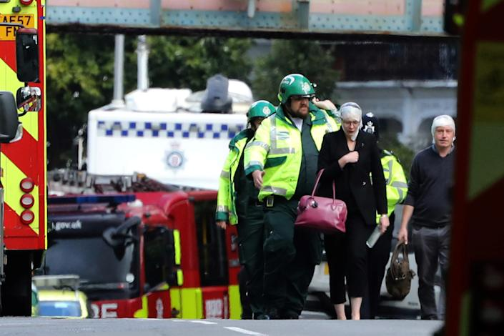 <p>An injured woman is led away after an incident at Parsons Green underground station in London, Britain, Sept. 15, 2017. (Photo: Luke MacGregor/Reuters) </p>