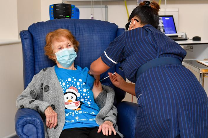 Margaret Keenan, 90, is the first patient in the United Kingdom to receive the Pfizer/BioNtech COVID-19 vaccine at University Hospital, Coventry, administered by nurse May Parsons, at the start of the largest ever immunization program in the UK's history. Dec. 8, 2020