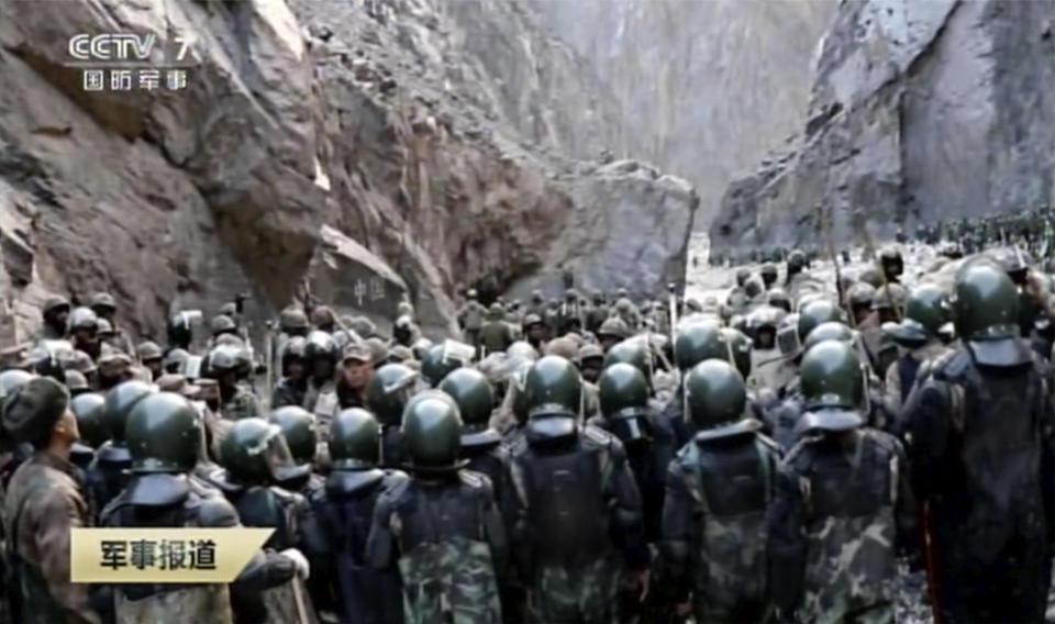 In this image taken from video footage run Feb. 19, 2021 by China's CCTV via AP Video, Indian and Chinese troops face off in the Galwan Valley on the disputed border between China and India, June 15, 2020. China's military said Friday, Feb. 19, 2021 that four of its soldiers were killed in a high-mountain border clash with Indian forces last year, the first time Beijing has publicly conceded its side suffered casualties in the deadliest incident between the Asian giants in nearly 45 years. (CCTV via AP Video)