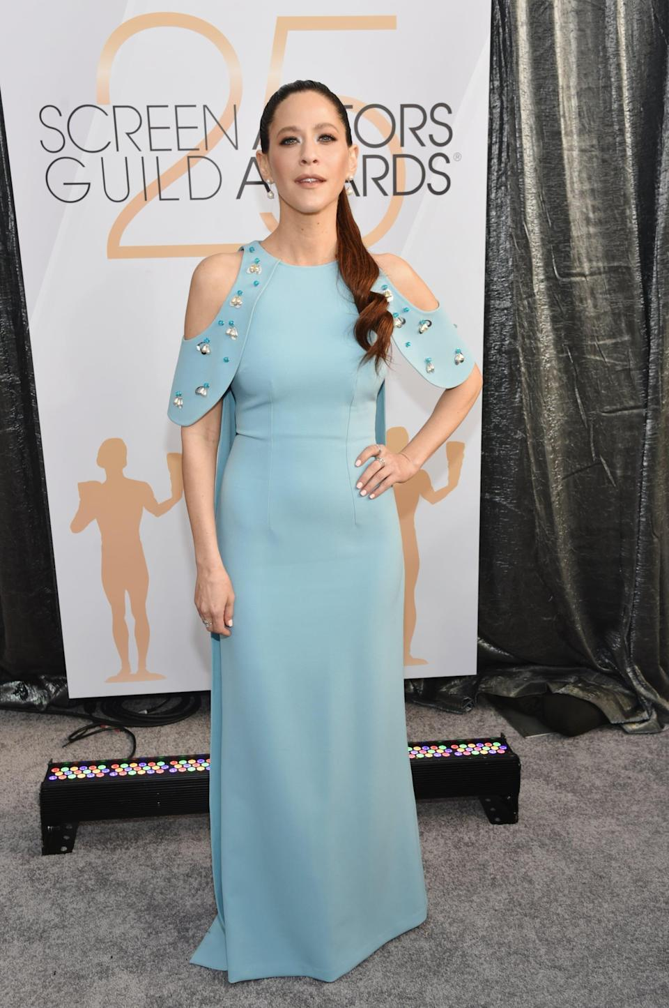 <p>Wearing a blue cold-shoulder Safiyaa gown. </p>