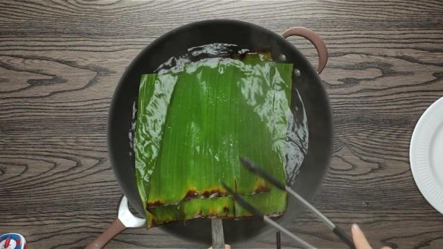 Boiling banana leaves in a wok