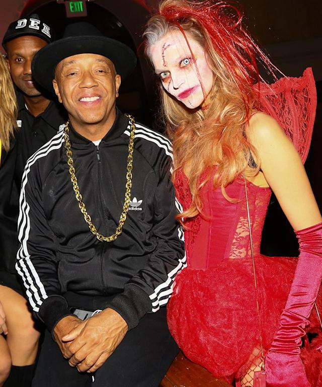 <p>We bet the music mogul didn't have to go far to pull together his Run-D.M.C costume! Of course, he promoted the legendary hip-hop group, which featured his brother Rev. Run. (Photo: Gabriel Olsen/WireImage) </p>