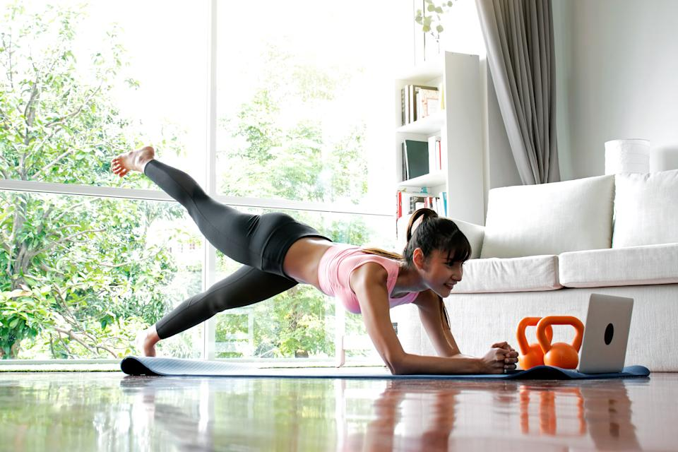 Woman doing exercise at home.