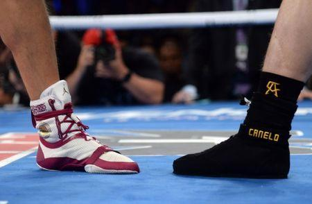 Sep 15, 2018; Las Vegas, NV, USA; A look at the footwear Canelo Alvarez (left) and Gennady Golovkin during the middleweight world championship boxing match at T-Mobile Arena. Alvarez won via majority decision. Mandatory Credit: Joe Camporeale-USA TODAY Sports