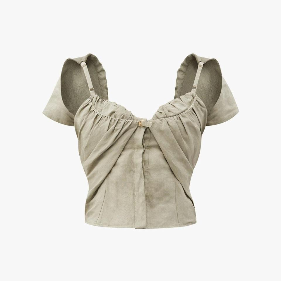 """$505, MATCHESFASHION.COM. <a href=""""https://www.matchesfashion.com/us/products/Jacquemus-Tovallo-ruched-linen-blend-bustier-top%09-1397917"""" rel=""""nofollow noopener"""" target=""""_blank"""" data-ylk=""""slk:Get it now!"""" class=""""link rapid-noclick-resp"""">Get it now!</a>"""