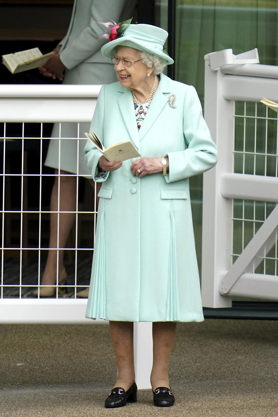 Britain's Queen Elizabeth II looks on, during day five of of the Royal Ascot horserace meeting, at Ascot Racecourse, in Ascot, England, Saturday June 19, 2021. (Andrew Matthews/PA via AP)