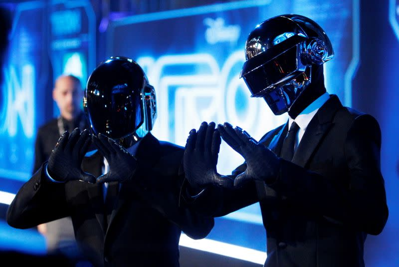 """FILE PHOTO: Musicians Banglater and de Homem-Christo of Daft Punk pose at the world premiere of the film """"TRON: Legacy"""" in Hollywood, California"""