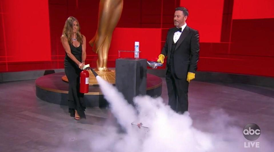 <p>Jennifer Aniston came to literally put out fires started by Jimmy Kimmel, so maybe we should cut her a little slack for wearing yet another simple black vintage Dior gown she may or may not have worn about a thousand times before. If it gets the job done, why not go with what works?</p>