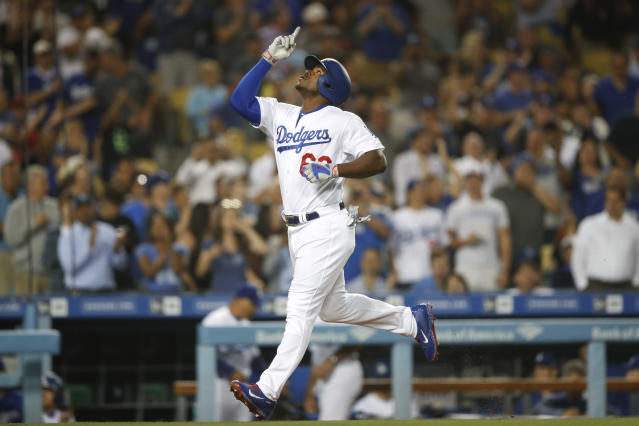 Los Angeles Dodgers' Yasiel Puig celebrates his two-run home run during the fourth inning of a baseball game against the Texas Rangers, Tuesday, June 12, 2018, in Los Angeles. (AP Photo/Jae C. Hong)