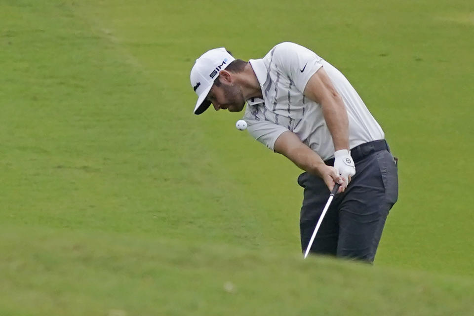 Corey Conners of Canada hits along the 18th fairway during the first round of the Sanderson Farms Championship golf tournament in Jackson, Miss., Thursday, Sept. 30, 2021. (AP Photo/Rogelio V. Solis)