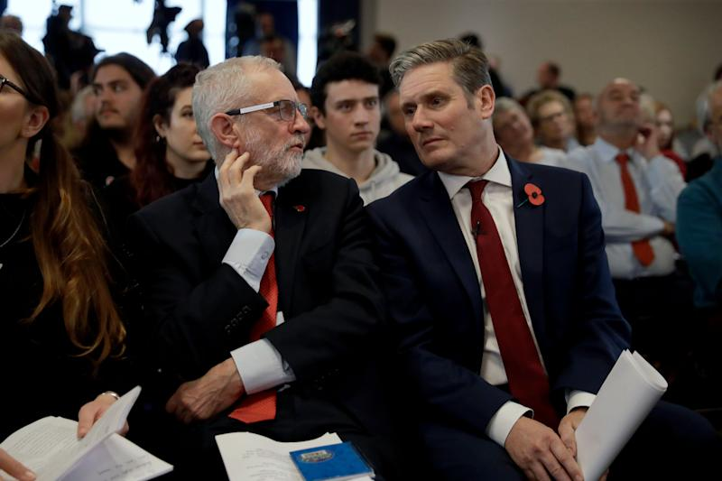 Jeremy Corbyn chats to Keir Starmer during the 2019 general election campaign. (Photo: ASSOCIATED PRESS)