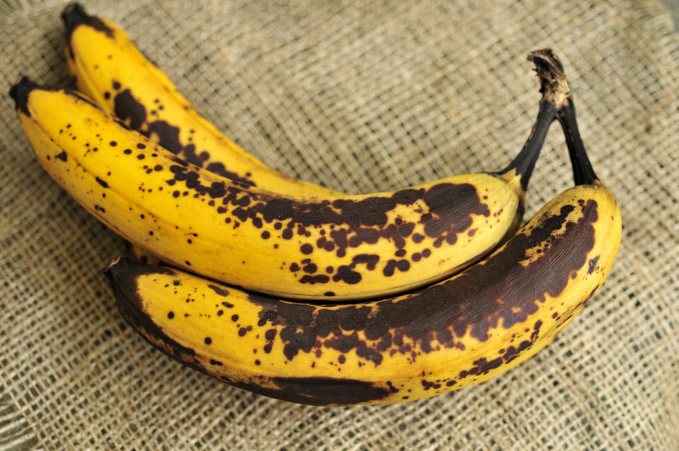 """Trio of bananas ripe on burlap.  FOR MORE FOOD, CLICK("""